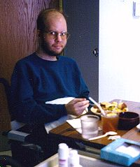 Andy practising feeding himself with his right hand, late Dec. 1996