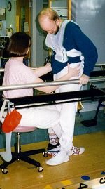Andy in physical therapy after leaving the hospital, late Dec. 1996