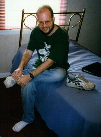 Andy getting ready to go outside, in his room at FINR, April 1997